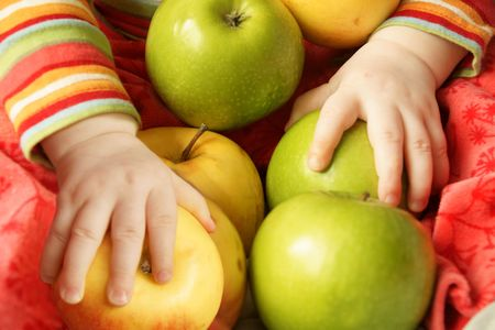little hands hold a lot of apples