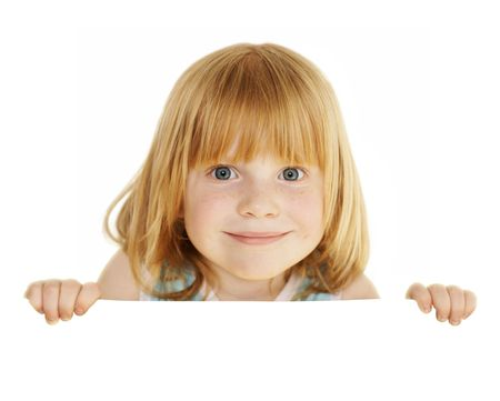 naughty child: playful redhead 4 years girl holding empty blank board with space for text, isolated on white