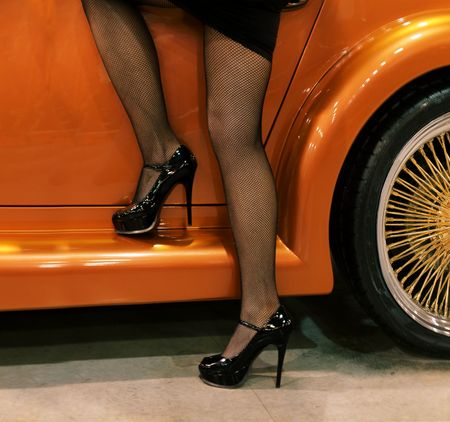 beautiful long legs and the luxury golden auto