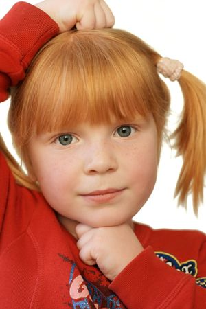 cute redhead girl with very serious expression Stock Photo