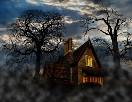 strange house with naked trees and fog, Halloween night photo