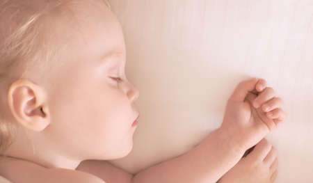 cute little girl sleeping, soft focus, space for text photo