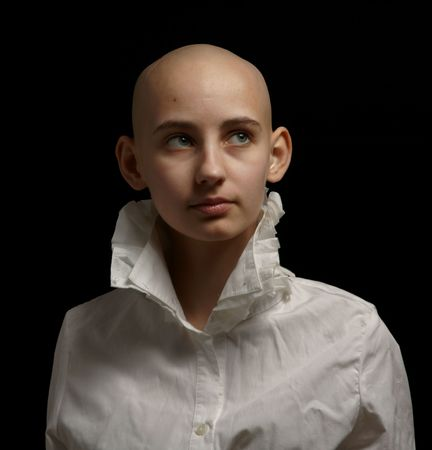 bald girl: portrait cancer survivor girl on black background