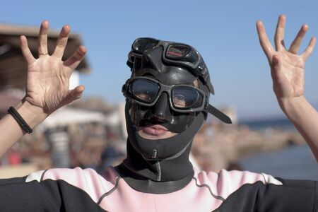portrait girl-diver in mask and swimsuit, doing  Stock Photo - 8765755