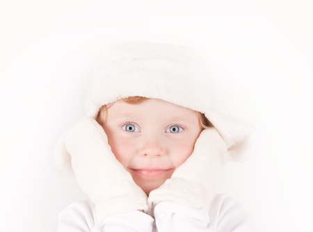blue eyed: little girl in white winter fleece hat with ear flaps & mittens portrait on white