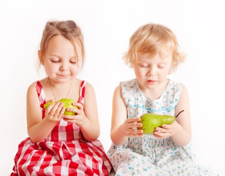 two little cute girls with pears photo