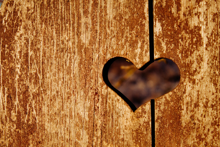 heart-shaped slot in the shabby wooden surface