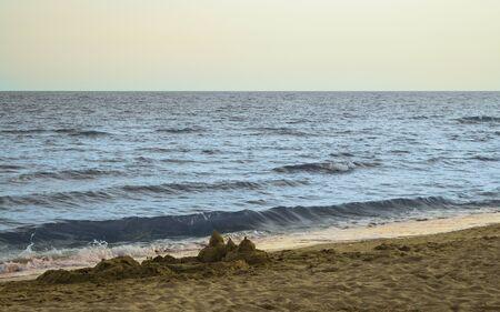 Built sand castle on the sea coast