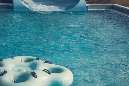 Quadruple rubber ring for riding on the water slides, swim in the pool at the water park Banco de Imagens