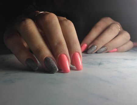 Colorful manicure with pink glossy finish. Long square nails with grey sequins design.
