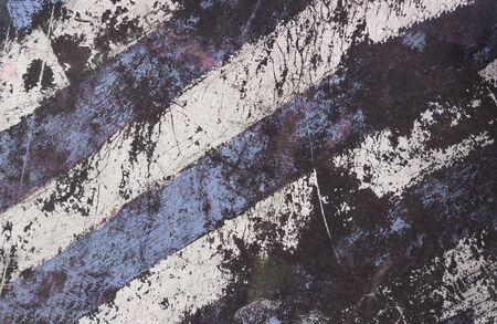Striped damaged texture with cracks and blue and white stripes.Post-apocalyptic background with colorful stripes. Destroyed sign dimensional transport with cracks and spots. Banco de Imagens