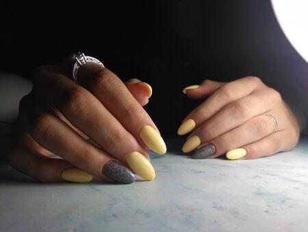 Yellow gel polish with grey design and sequins Zdjęcie Seryjne