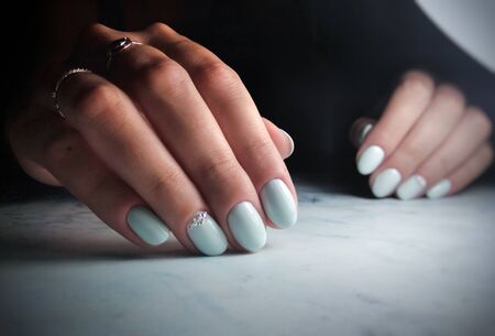 Delicate blue manicure with rhinestone design