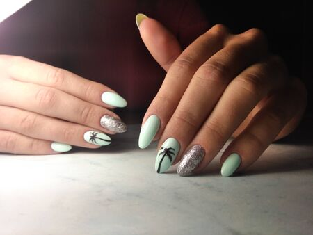 Delicate blue manicure with painted palm and sequins Stok Fotoğraf