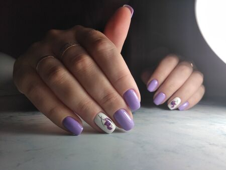 Purple gel polish with white design and pattern