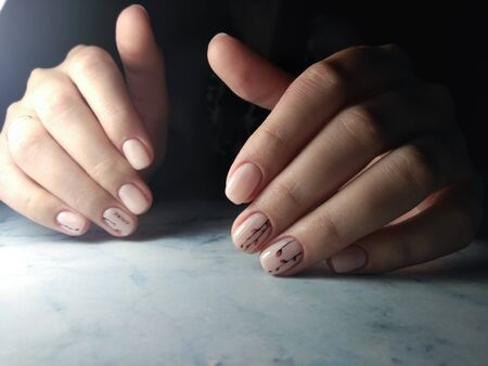 Delicate pink gel polish, neat manicure with twig design