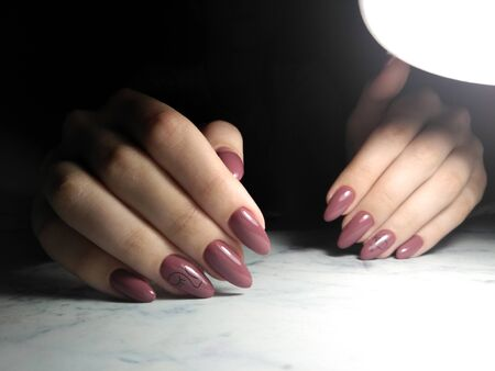 Burgundy brown solid shellac, with painted face design Archivio Fotografico - 138553871