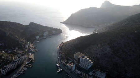 The city is located in a sea bay among the mountains.