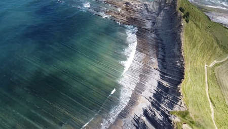 Beautiful view of the sea and mountains. A bird's-eye view of the rocky coast. Top view Imagens