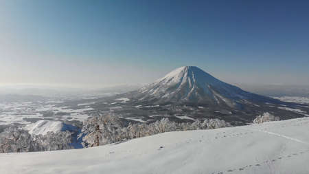 Mount Fuji in Japan in winter. A volcano covered with snow. Snow mountain from afar