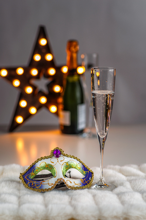 Champagne in glasses and a carnival mask Stock Photo