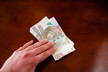 Money in 500 PLN banknotes in your hands