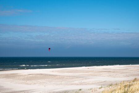 Kitesurfers on the beach in Karwia in Poland