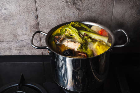 cooking broth on chicken and vegetables