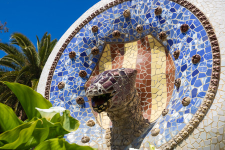 Fountain with the snake head and Catalan flag on Dragon Staircase in Park Güell, Barcelona, Spain - Image