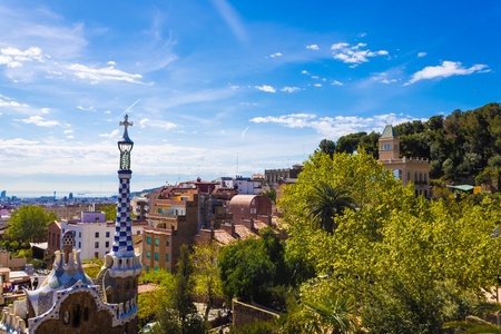 Beautiful architecture and trees of Park Guell in Barcelona - Image