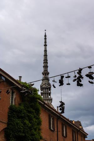 View at the Mole Antonelliana with the string with shoes, Turin, Piedmont, Italy - Image Imagens