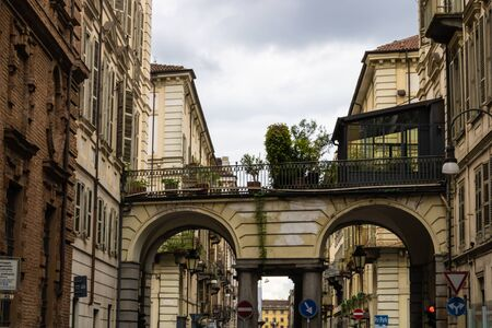 TURIN, ITALY - 25 May 2019: Passage with plants and Turin street view, Torino, Italy - Image Editorial