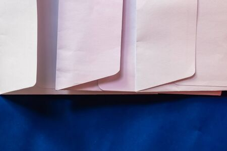 Three white paper envelopes closeup with the blue background - Image