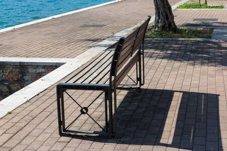 Bench on the waterfront of Garda lake, Bardolino. Italy - Image