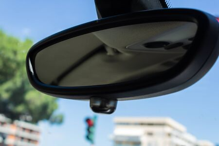 Car rear view mirror closeup, view from inside the car - Image