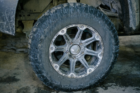 big dirty wheel on the drive from four wheel drive  pick-up truck Reklamní fotografie