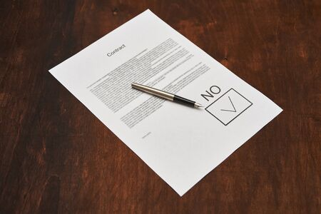 contract blank for rejection signed no. ink pen lies on paper