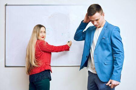 management training. worker man pondered. woman blonde teacher.