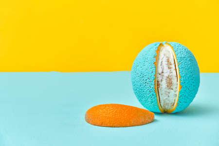 peeled lobule peel of an orange painted in turquoise color. creative design concept Stock fotó