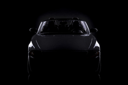 modell: gray silhouette of car on black background Stock Photo