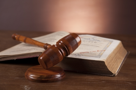 Law and justice stuff on wood table and dark background  Stock Photo - 16114430