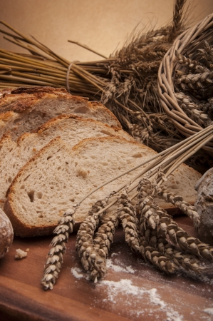 Traditional country theme with bread and cereals Stock Photo