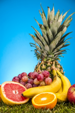 Fitness theme with fruits, bright background Stock Photo