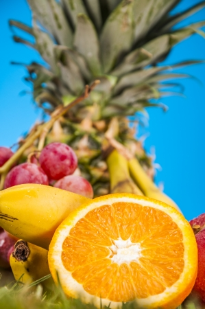 Fitness theme with fruits, bright background photo
