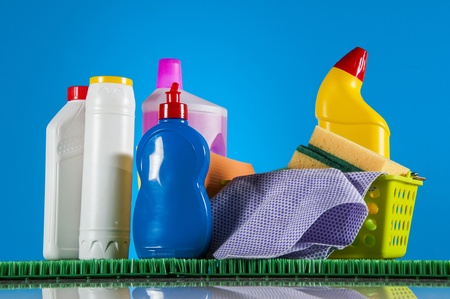 Cleaning set on blue vivid background Stock Photo