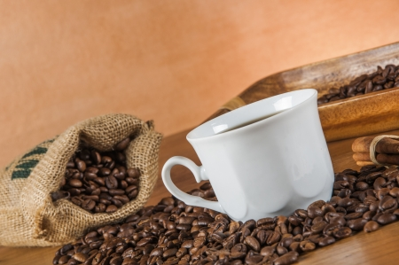 ambient light: Coffee beans, wooden table with ambient light Stock Photo
