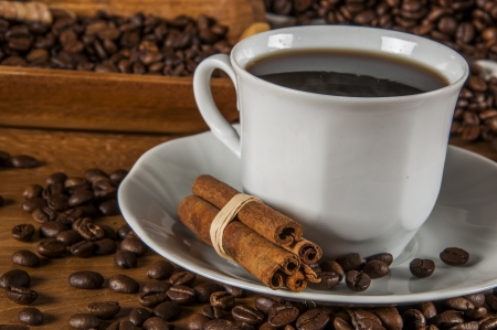 Coffee theme with wooden table and dark background photo
