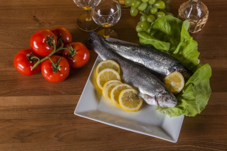 Raw fish on light background, mediterranean composition Stock Photo