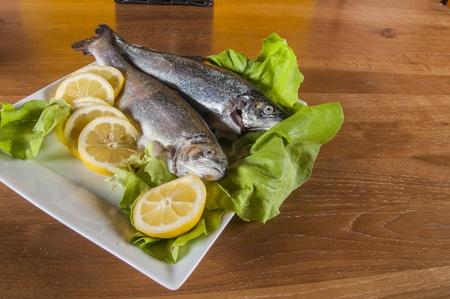 Raw fish on the plate, mediterranean theme Stock Photo