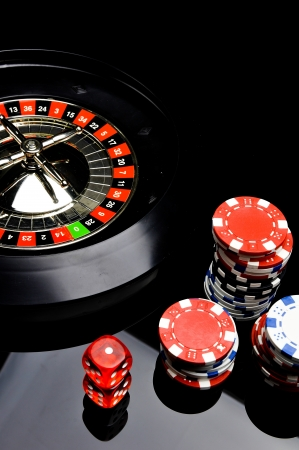 Dark roulette, casino theme with gambling stuff photo